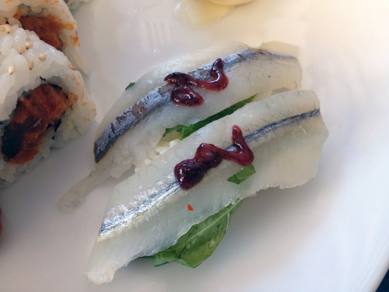 Two pieces of sayori (Hyporhamphus sajori) nigiri. (Image Credit: Ben Young Landis/CC-BY)