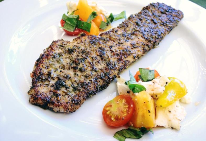 Rockfish fillet, blackened. Served with heirloom tomato and mozzarella salad. (Image Credit: Ben Young Landis/CC-BY)