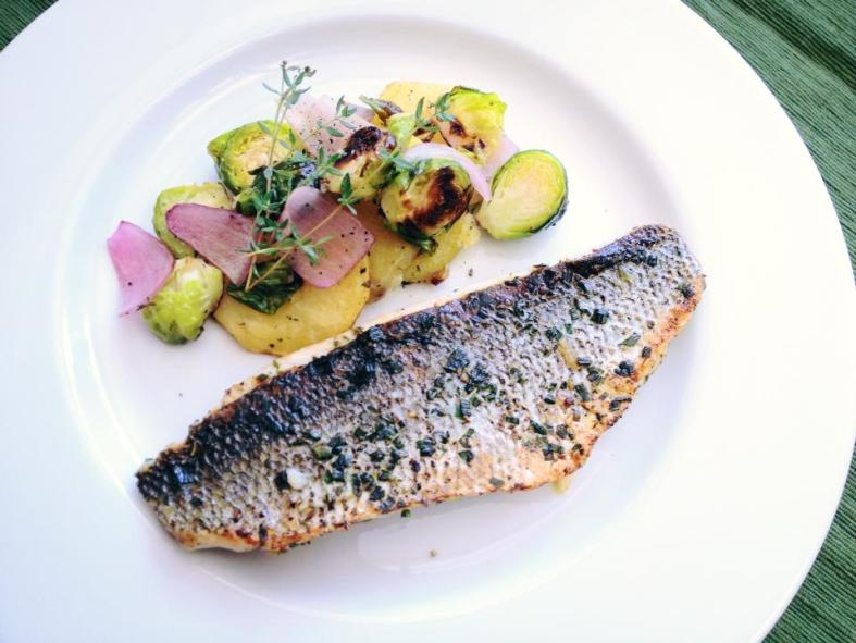 Pan-seared loup de mer with oven-roasted potatoes and Brussels sprouts. (Ben Young Landis/CC-BY)