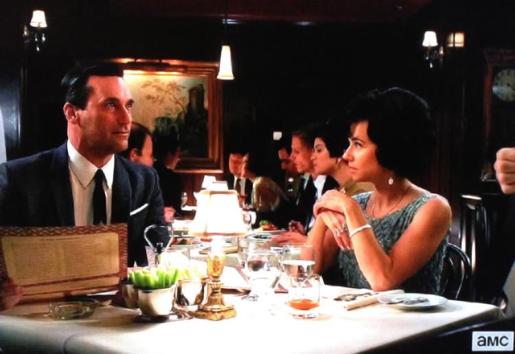 "Don Draper (Jon Hamm) and Sylvia Rosen (Linda Cardellini) in the U.S. television series ""Mad Men"", preparing to dine on branzino in the sixth season episode ""Collaborators"" (Image Credit: AMC/Lionsgate)"