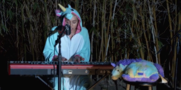 Miley Cyrus performs a tribute to Pablow the Blowfish on May 18th. (Image Credit: Happy Hippie Foundation)